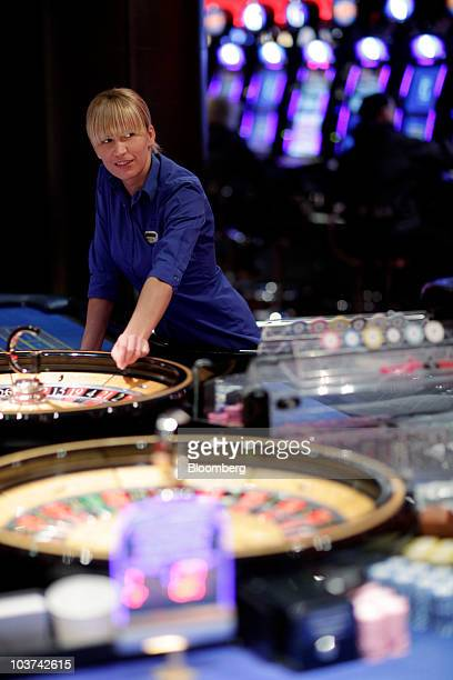 Croupier Aneta Kruk spins a roulette wheel at Gala Casino operated by Gala Coral Group Ltd in London UK on Monday Aug 30 2010 Gala Coral Group Ltd...