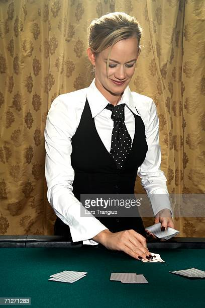 A croupier by a game of poker.