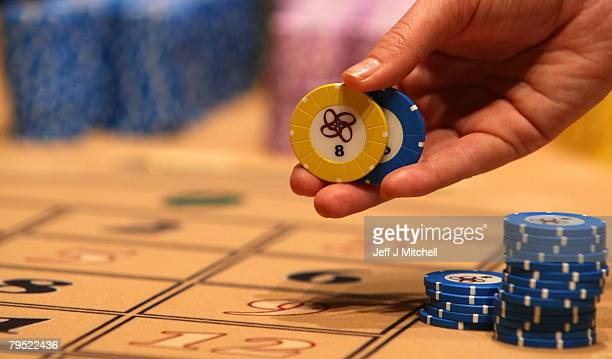 A croupier holds chips at the new luxury casino which opens tomorrow February 5 2008 in Glasgow Scotland This 25m GBP venue named Alea opens on the...
