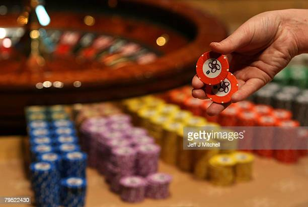 A croupier holds chips at the new luxury casino which opens tomorrow on February 5 2008 in Glasgow Scotland This 25m GBP venue named Alea opens on...