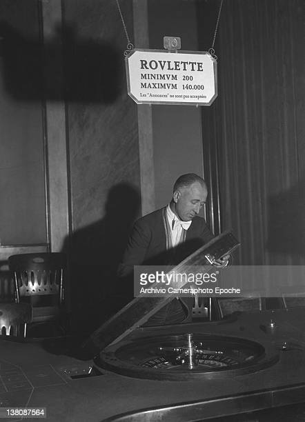 A croupier setting the roulette game at the San Remo Casino 1950