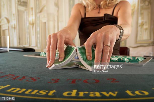croupier shuffling cards at blackjack table, mid section - shuffling stock photos and pictures