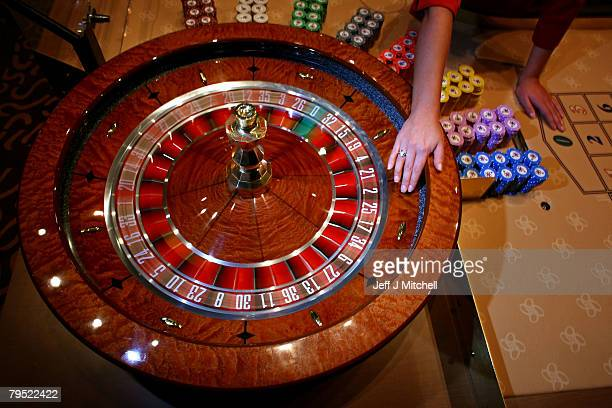 A croupier spins a roulette wheel at the new luxury casino which opens tomorrow on February 5 2008 in Glasgow Scotland This 25m GBP venue named Alea...