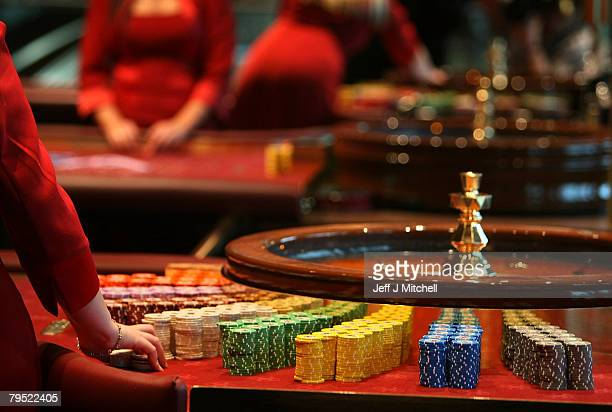 Croupiers hold chips at the new luxury casino which opens tomorrow on February 5 2008 in Glasgow Scotland This 25m GBP venue named Alea opens on the...