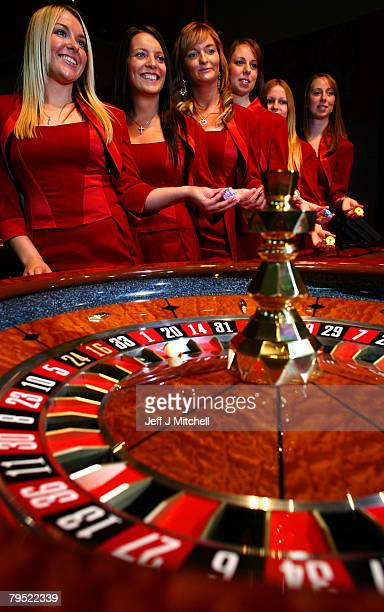 Croupiers pose at a new luxury casino which opens tomorrow February 5 2008 in Glasgow Scotland This £25m venue named Alea opens on the Clyde at...