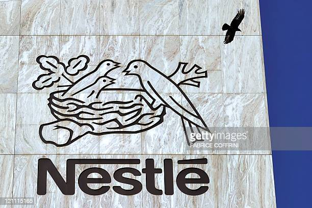 A crow flies above a sign of the world's biggest food company Nestle at their headquarters on August 10 2011 in Vevey Nestle posted a 137 percent...