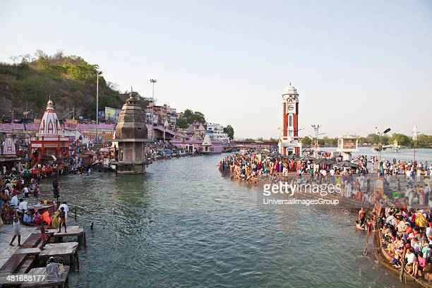 Crowd and a clock tower at Malviya Dwipa River Ganges Haridwar Uttarakhand India