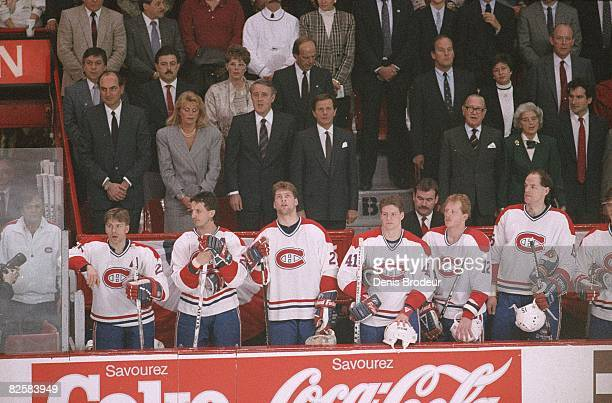 Crowd and players stand for the national anthem at the Montreal Forum during the late 1980s. Prime minister Brian Mulroney is third from the left in...