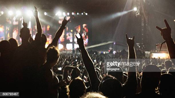 crowd at a music concert - metal music stock photos and pictures