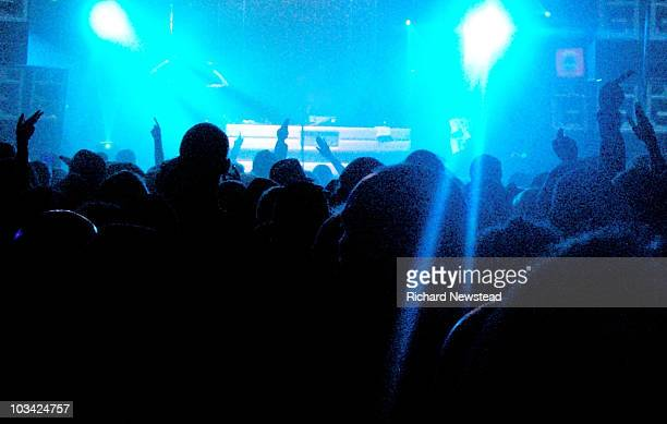 crowd at a rave - nightclub stock pictures, royalty-free photos & images