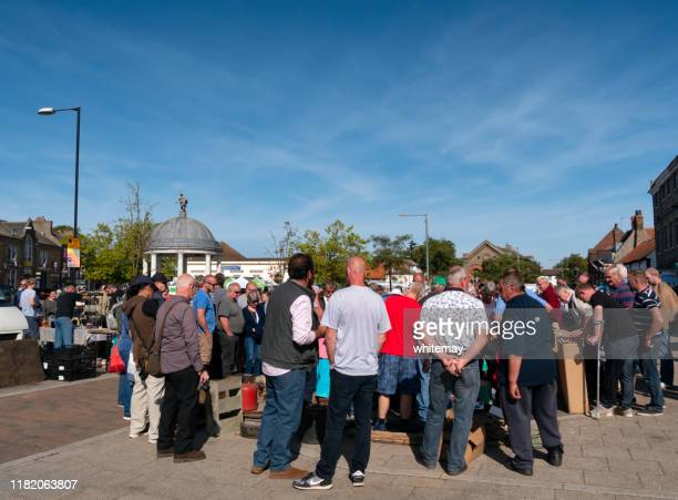 crowd at a street auction in swaffham, norfolk - auction stock pictures, royalty-free photos & images