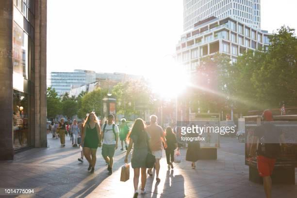 crowd at a sunny summer day, shopping at kurfürstendamm, berlin - kurfürstendamm stock pictures, royalty-free photos & images