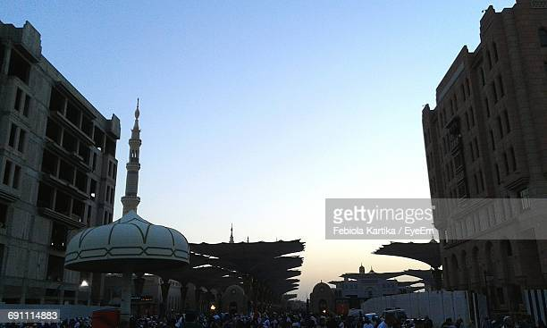 Crowd At Al-Masjid An-Nabawi Against Sky In Morning