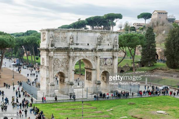 Crowd At Arch Of Constantine Against Sky