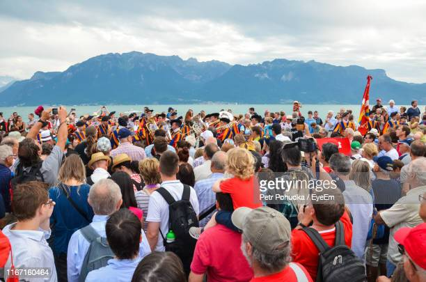 crowd at beach during event against sky - national landmark stock pictures, royalty-free photos & images