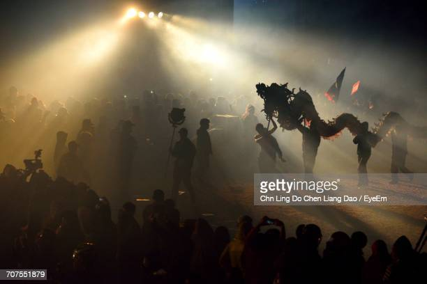 crowd at chinese dragon performance - chinese dragon stock pictures, royalty-free photos & images