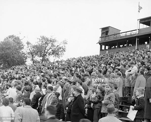 crowd at football game - old american football stock photos and pictures
