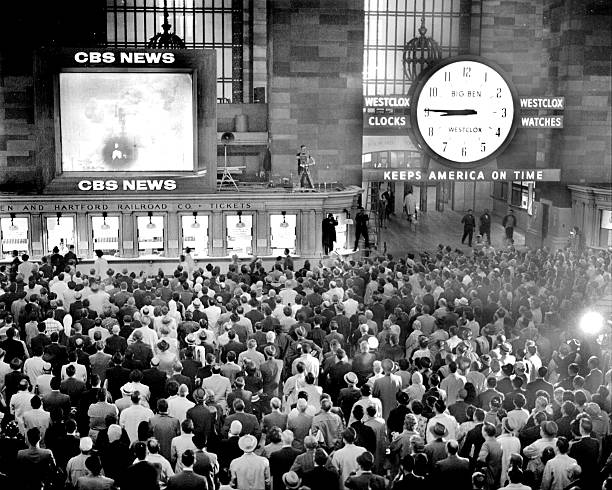 Crowd at Grand Central Station watch astronaut Scott Carpent