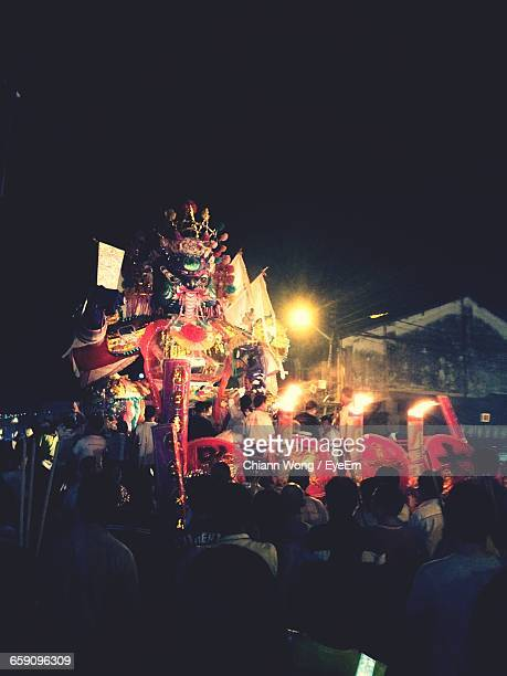 crowd at hungry ghost festival against sky - hungry ghost festivals in malaysia foto e immagini stock