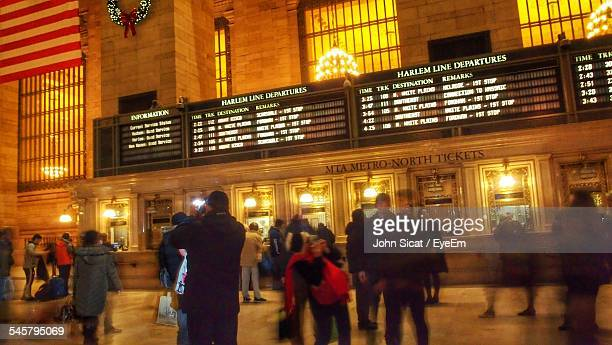crowd at illuminated grand central station - grand central station stock photos and pictures