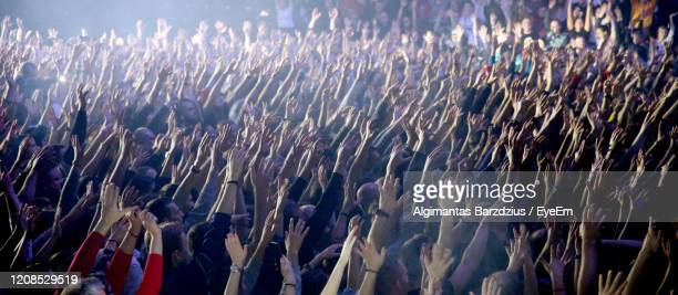 crowd at music concert - performance stock pictures, royalty-free photos & images
