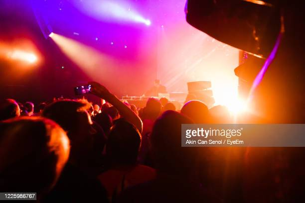 crowd at music concert - nightclub stock pictures, royalty-free photos & images