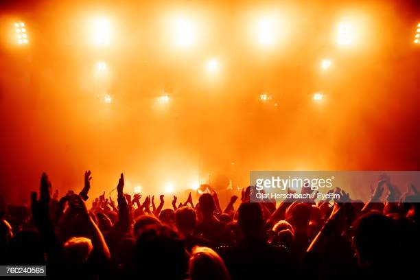 crowd at music concert - atmosphere stock pictures, royalty-free photos & images