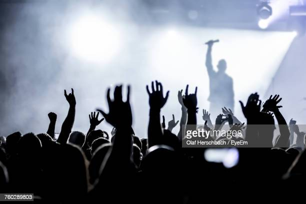 crowd at music concert - singer stock pictures, royalty-free photos & images
