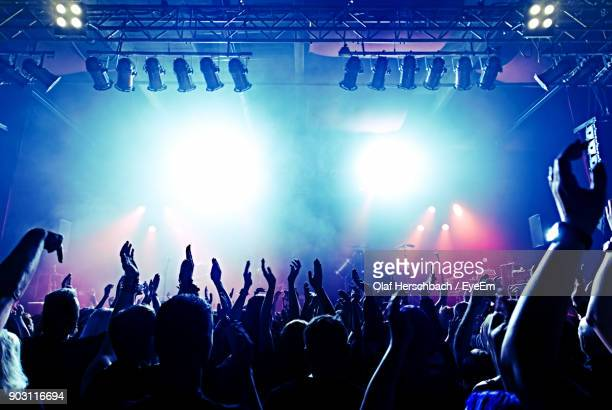 crowd at music concert - concert stock pictures, royalty-free photos & images