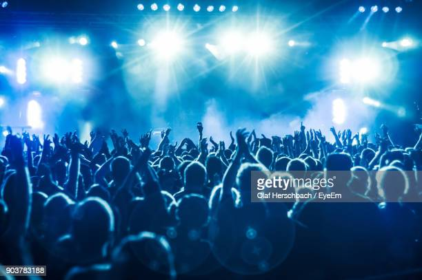 crowd at music concert - stage light stock pictures, royalty-free photos & images