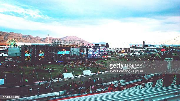 crowd at music festival against sky - exterior daylight stock pictures, royalty-free photos & images