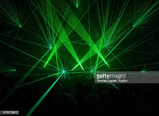 crowd at popular music concert - laser stock pictures, royalty-free photos & images
