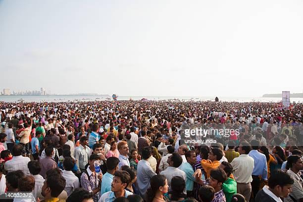 crowd at religious procession during ganpati visarjan ceremony, mumbai, maharashtra, india - ganesh chaturthi stock photos and pictures