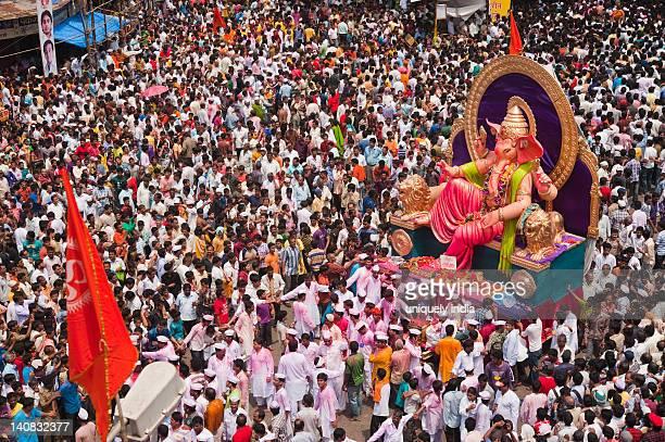 crowd at religious procession during ganpati visarjan ceremony, mumbai, maharashtra, india - ganesha stock photos and pictures