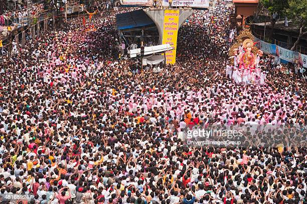 Crowd at religious procession during Ganpati visarjan ceremony Mumbai Maharashtra India