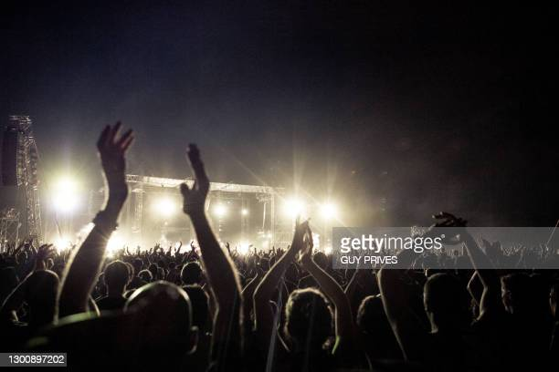 crowd at rock concert - music festival stock pictures, royalty-free photos & images