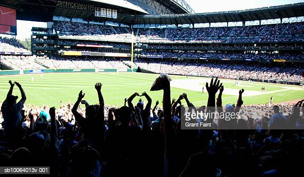 Crowd at stadium cheering during baseball match