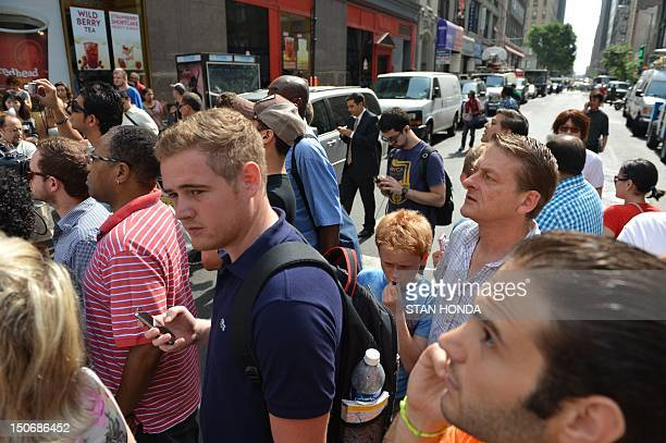 A crowd at the corner of 33rd street and Fifth Avenue in front of the Empire State Building after a shooting August 24 2012 in New York A gunman and...