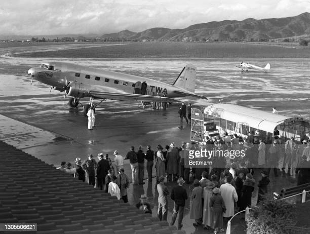 Crowd at Union Airport, Burbank, California is seen as Ekins boarded a TWA plane for the last leg of his around the world journey.