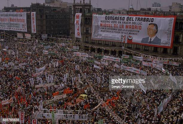 A crowd attends the closing of the presidential campaign of the PRI party for their candidate Miguel de la Madrid in the Zocalo square of Mexico City...