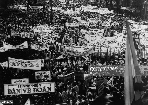 Crowd awaits the result of the referendum at Saigon, before the new republic of Vietnam is proclaimed. The majority of the population voted for...