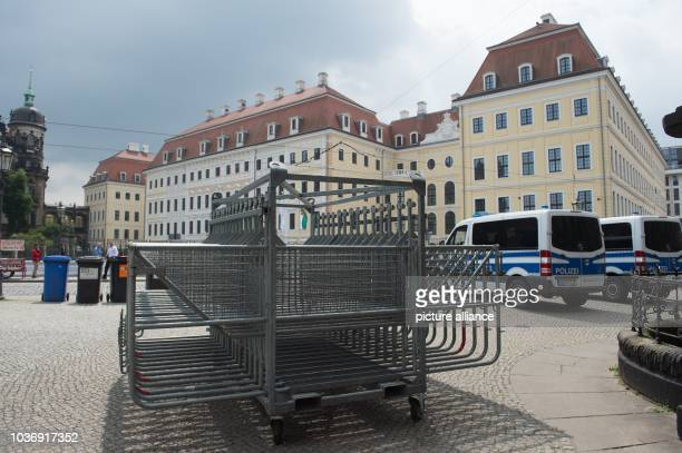 Crowd barriers and police cars stand in front of the Kempinski Hotel Taschenbergpalais on the occasion of the Bilderberg Conference in...
