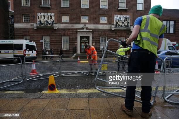 Crowd barriers are erected opposite the private Lindo Wing of St Mary's Hospital in central London on April 9 where Britain's Catherine Duchess of...