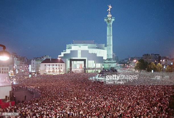 A crowd celebrates the bicentennial of the establishment of the French Republic in Place de la Bastille in Paris the site of the prison stormed by...
