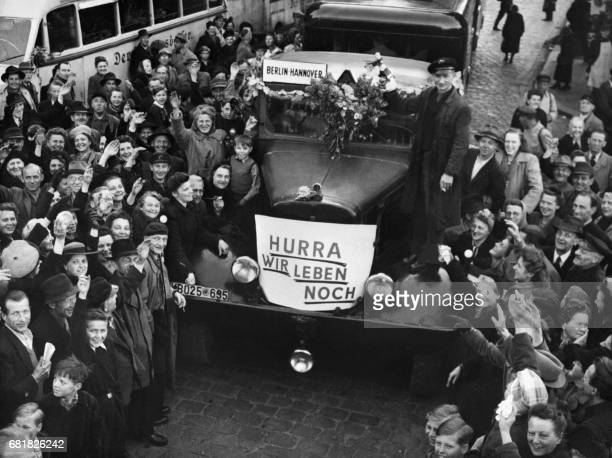 Crowd celebrates the end of the Berlin blockade with departures of first bus to the western sectors of Berlin Germany on May 13 1949 During the...