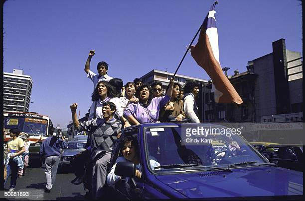 Crowd celebrating plebiscite NO vote victory defeating dictator Augusto Pinochet.
