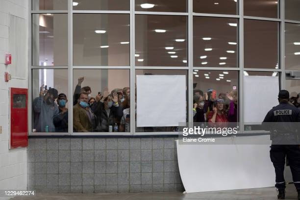 """Crowd chants """"stop the count,"""" and pounds on the glass windows and doors to the entrance of the Central Counting Board in the TCF Center after..."""