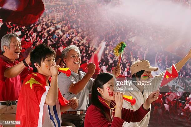 crowd cheering in stadium