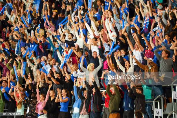 crowd cheering - fan enthusiast stock pictures, royalty-free photos & images