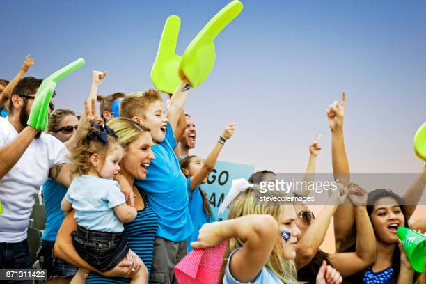 crowd cheering - cheering stock pictures, royalty-free photos & images